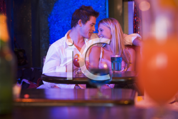 Royalty Free Photo of a Young Couple in a Bar