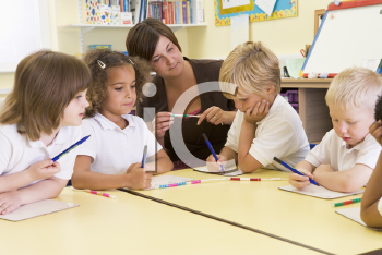 Royalty Free Photo of Students and a Teacher in Class