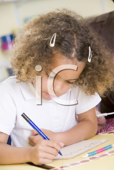 Royalty Free Photo of a Student Writing