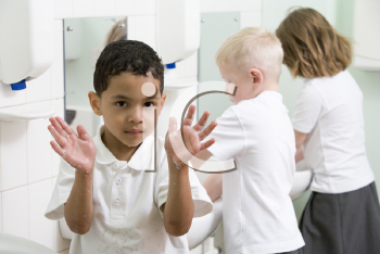 Royalty Free Photo of Students Washing Their Hands