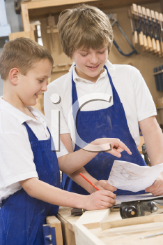 Royalty Free Photo of Students in a Woodworking Class
