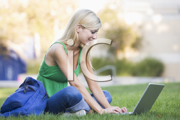 Royalty Free Photo of a Girl Outside With a Laptop