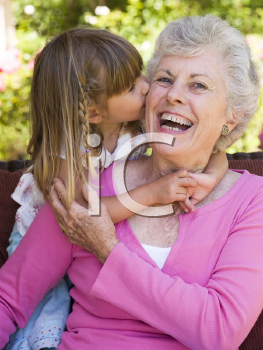 Royalty Free Photo of a Little Girl Kissing Her Grandma