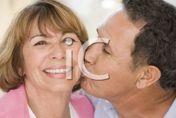 Royalty Free Photo of a Couple Kissing