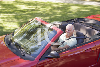 Royalty Free Photo of a Man in a Convertible