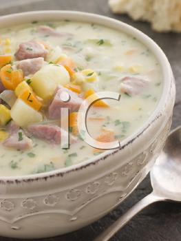 Royalty Free Photo of a Bowl of Bacon and Corn Chowder with Soda Bread