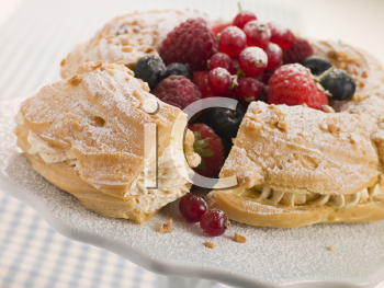 Royalty Free Photo of Paris Brest With Mixed Berries and Hazelnuts