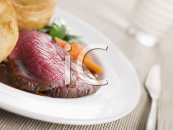 Royalty Free Photo of Beef With Yorkshire Pudding and Vegetables