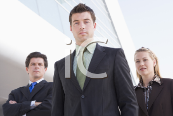 Royalty Free Photo of Three People Outside a Building