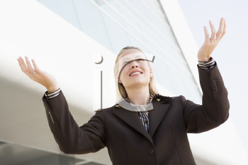 Royalty Free Photo of a Woman Outside With Her Arms Raised