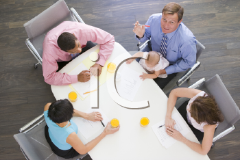 Royalty Free Photo of People and a Baby in a Boardroom
