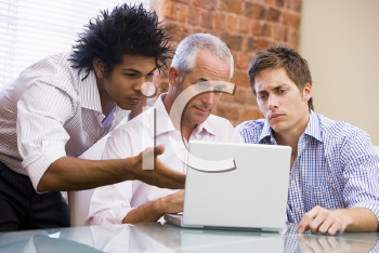 Royalty Free Photo of Three Men Looking at a Laptop