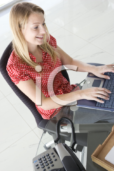 Royalty Free Photo of a Girl With a Laptop