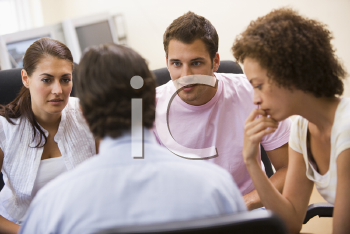 Royalty Free Photo of Three People Listening to a Man