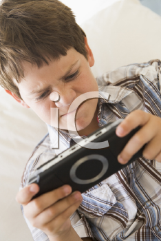 Royalty Free Photo of a Young Boy With a Game Control