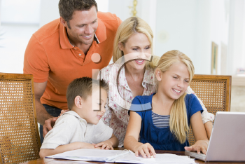 Royalty Free Photo of a Couple Helping Their Children With Homework