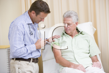 Royalty Free Photo of a Doctor Giving a Man a Needle