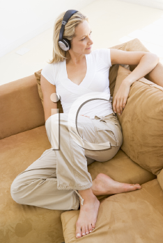 Royalty Free Photo of a Woman Listening to Headphones