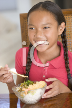 Royalty Free Photo of a Girl Eating Chinese Food