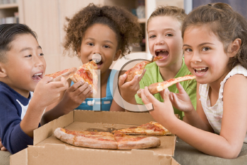 Royalty Free Photo of Children Eating Pizza