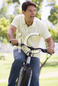 Royalty Free Photo of a Man on a Bike