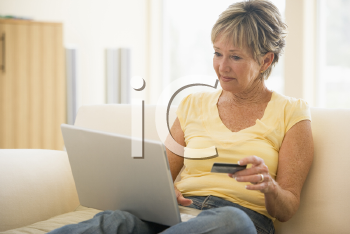 Royalty Free Photo of a Woman With a Laptop and Credit Card