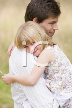 Royalty Free Photo of a Father Holding His Daughter