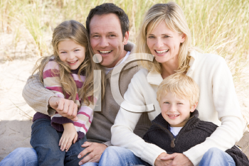 Royalty Free Photo of a Family Sitting in the Sand