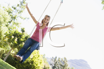 Royalty Free Photo of a Woman on a Swing