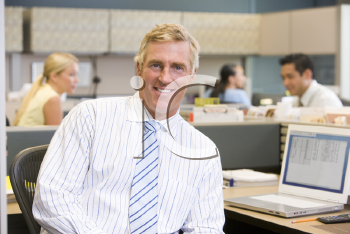 Royalty Free Photo of a Man in an Office Cubicle
