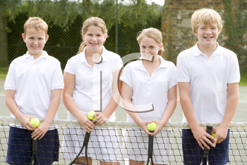 Royalty Free Photo of Kids at a Tennis Court