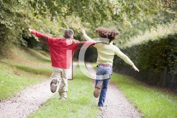 Royalty Free Photo of Friends Running on a Path