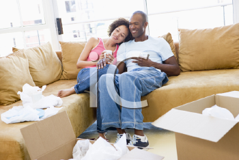 Royalty Free Photo of a Couple Relaxing on Moving Day