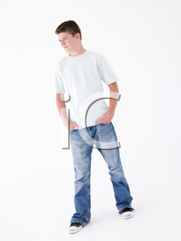 Teenage boy standing with hands in pockets