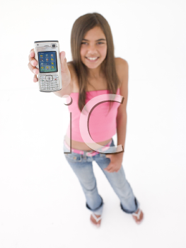 Young girl holding up cellular phone and smiling