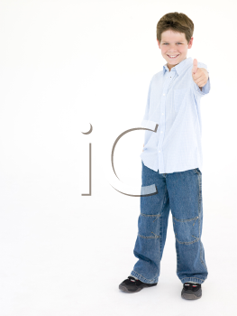 Young boy giving thumbs up smiling