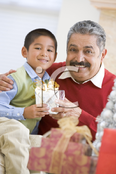 Royalty Free Photo of a Boy Surprising His Grandfather With a Gift