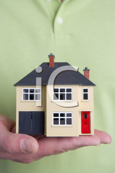 Royalty Free Photo of a Hand Holding a House