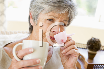 Royalty Free Photo of a Woman Blowing Her Nose