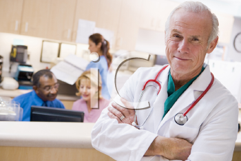 Royalty Free Photo of a Doctor With the Reception Area Behind Him