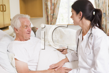 Royalty Free Photo of a Doctor Talking to a Patient