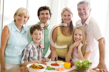 Royalty Free Photo of a Family Preparing Food
