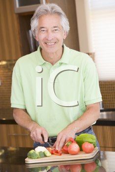 Royalty Free Photo of a Man Chopping Vegetables