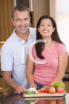 Royalty Free Photo of a Couple Preparing Vegetables