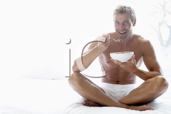 Royalty Free Photo of a Man Eating Cereal