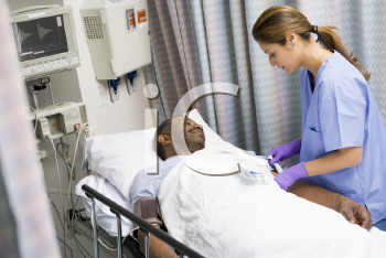 Royalty Free Photo of a Nurse Caring for a Patient