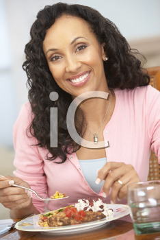 Royalty Free Photo of a Woman Enjoying a Meal