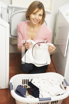 Royalty Free Photo of a Woman Doing Laundry