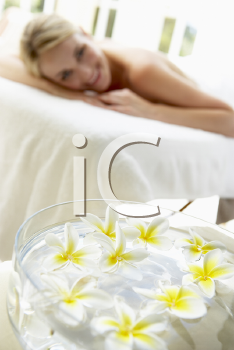 Royalty Free Photo of a Woman on a Massage Table With Flowers in the Background