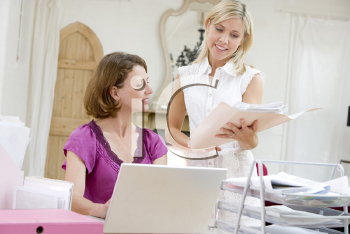Royalty Free Photo of Women Looking at Paperwork